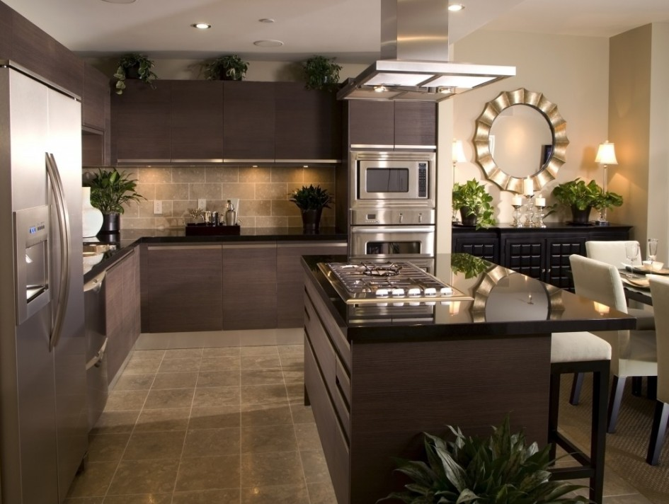 stainless-steel-home-depot-kitchen-appliance-packages-with-cream-tile-kitchen-backsplash-facing-large-black-granite-countertop-kitchen-island-945x712 20+ Hottest Home Decor Trends for 2020