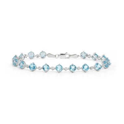 14k-White-Gold-Blue-Topaz-and-Diamond-Bracelet How To Hide Skin Problems And Wrinkles Using Jewelry?