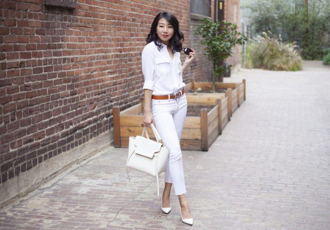 poshclassymom-all-white-equipment-silk-blouse-jbrand-ag-white-skinny-jeans-manolo-blahnik-bb-hermes-belt-celine-belt-bag-karen-walker-sunglasses-chanel-earrings-cartier-amulette-6-675x471 15 Shiny Spring Outfit Ideas for Working Ladies