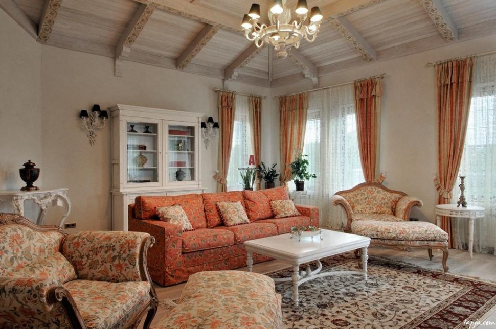 Graceful-living-room-decoration-ideas-with-orange-floral-pattern-sofa-and-fancy-chandelier-above-white-table-including-white-brown-floral-rug-as-well-wooden-ceiling-and-striped-curtain-970x644 20+ Hottest Curtain Designs for 2019