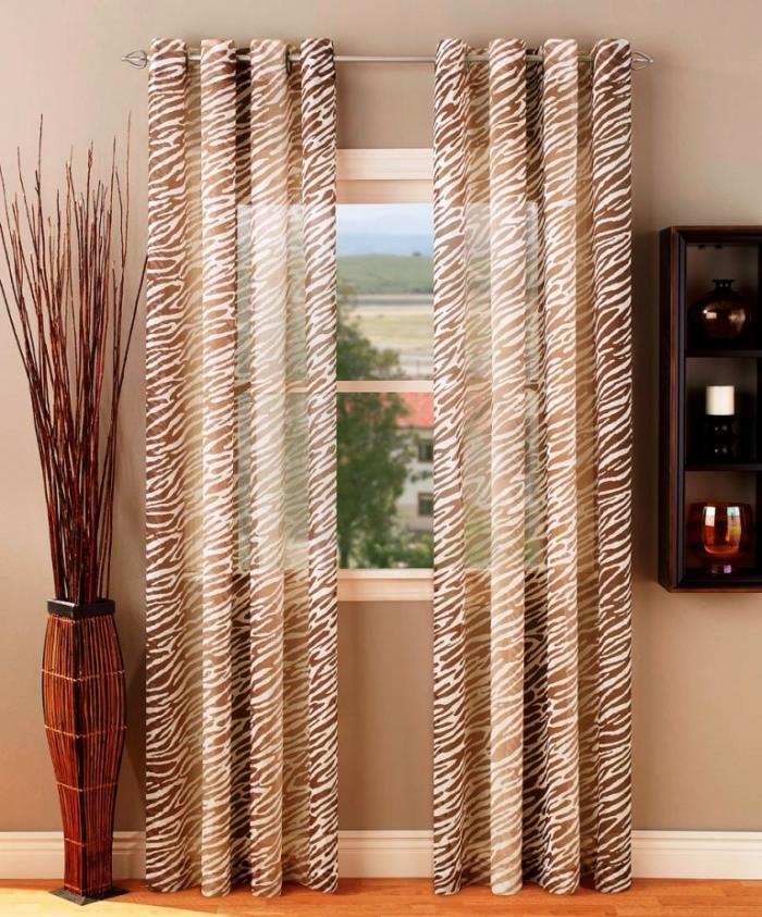 safari-sheer-grommet-top-brown-sheer-curtains-set-on-small-bay-window-700x843 20+ Hottest Curtain Designs for 2019