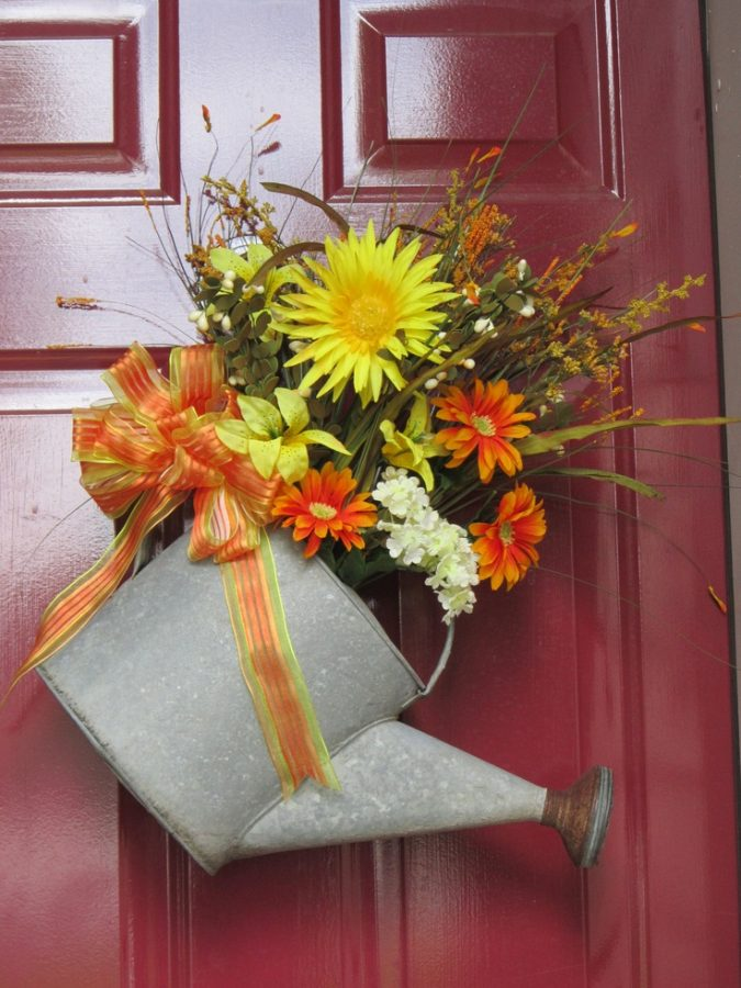 Watering-can-with-flowers-front-door-decoration-2-675x900 7 Vibrant Front Door Decorations for Summer 2020