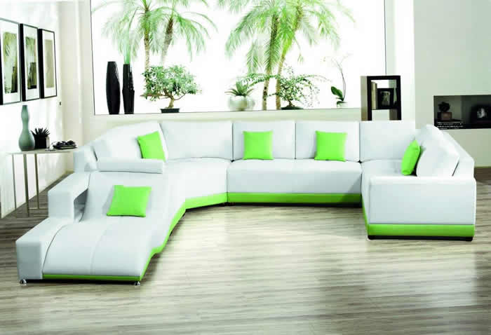 modern-white-leather-sectional-sofa-with-green-accent-and-chaise 5 Outdated Home Decor Trends That Are Coming Again in 2020
