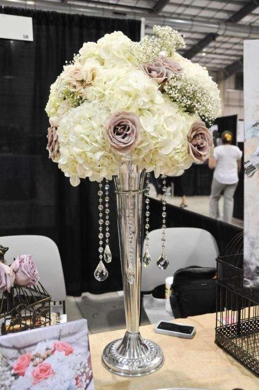 tall-wedding-centerpieces-1 11 Tips on Mixing Antique and Modern Décor Styles