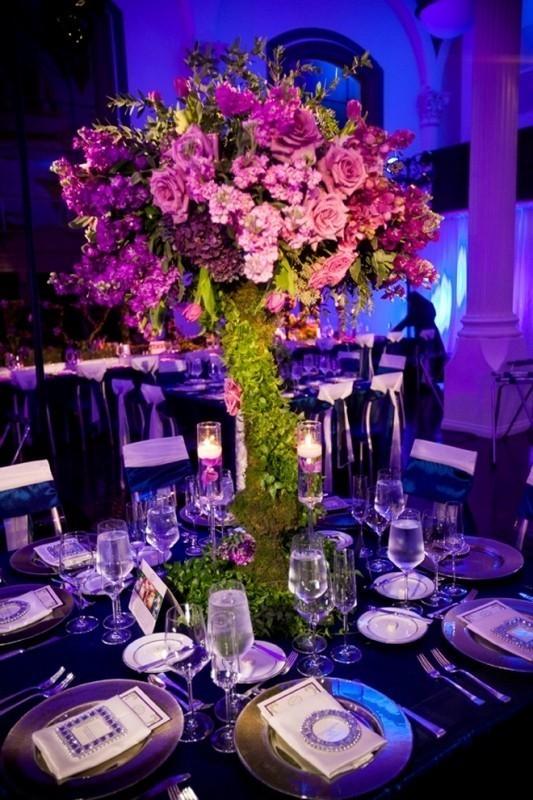 tall-wedding-centerpieces-10 79+ Insanely Stunning Wedding Centerpiece Ideas
