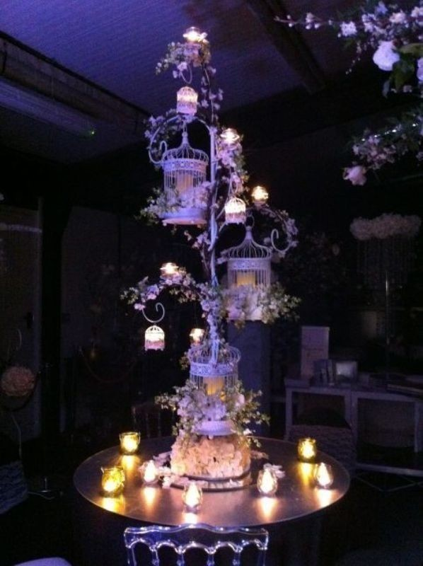 tall-wedding-centerpieces-29 79+ Insanely Stunning Wedding Centerpiece Ideas