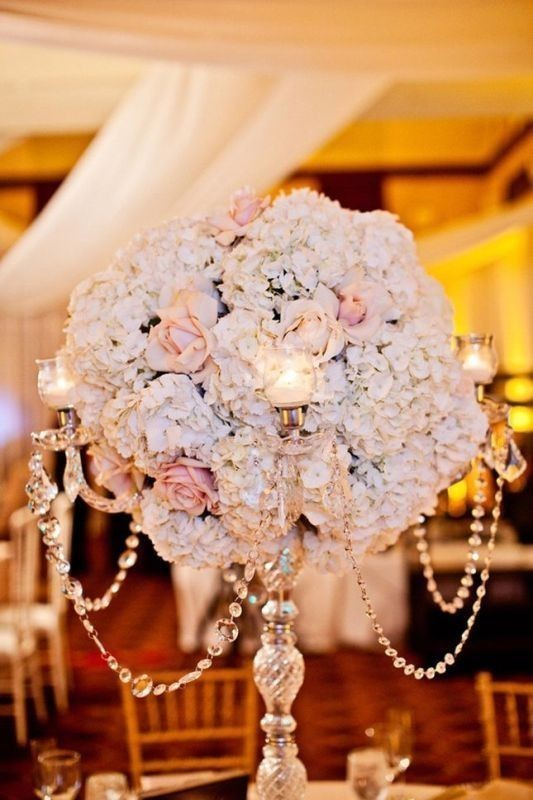 tall-wedding-centerpieces-6 11 Tips on Mixing Antique and Modern Décor Styles