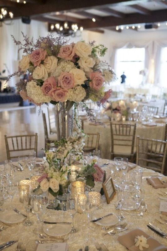 tall-wedding-centerpieces-8 11 Tips on Mixing Antique and Modern Décor Styles