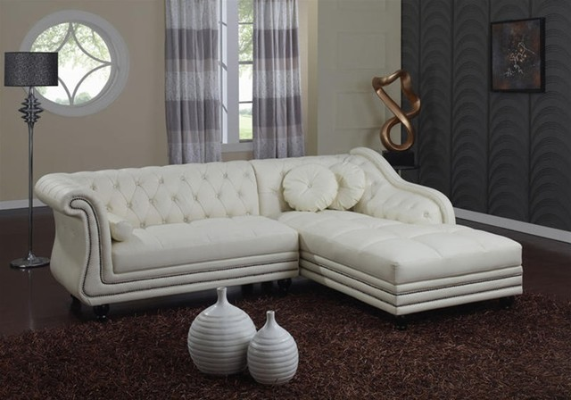 traditional-white-leather-sectional-sofa-with-chaise-and-cushions 5 Outdated Home Decor Trends That Are Coming Again in 2020