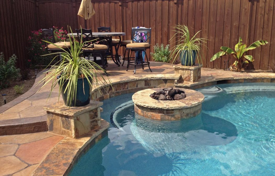 Fire-Pit-inside-Pool-with-Bench-in-Frisco Delightful and Affordable Fire pit Decoration Designs in 2018