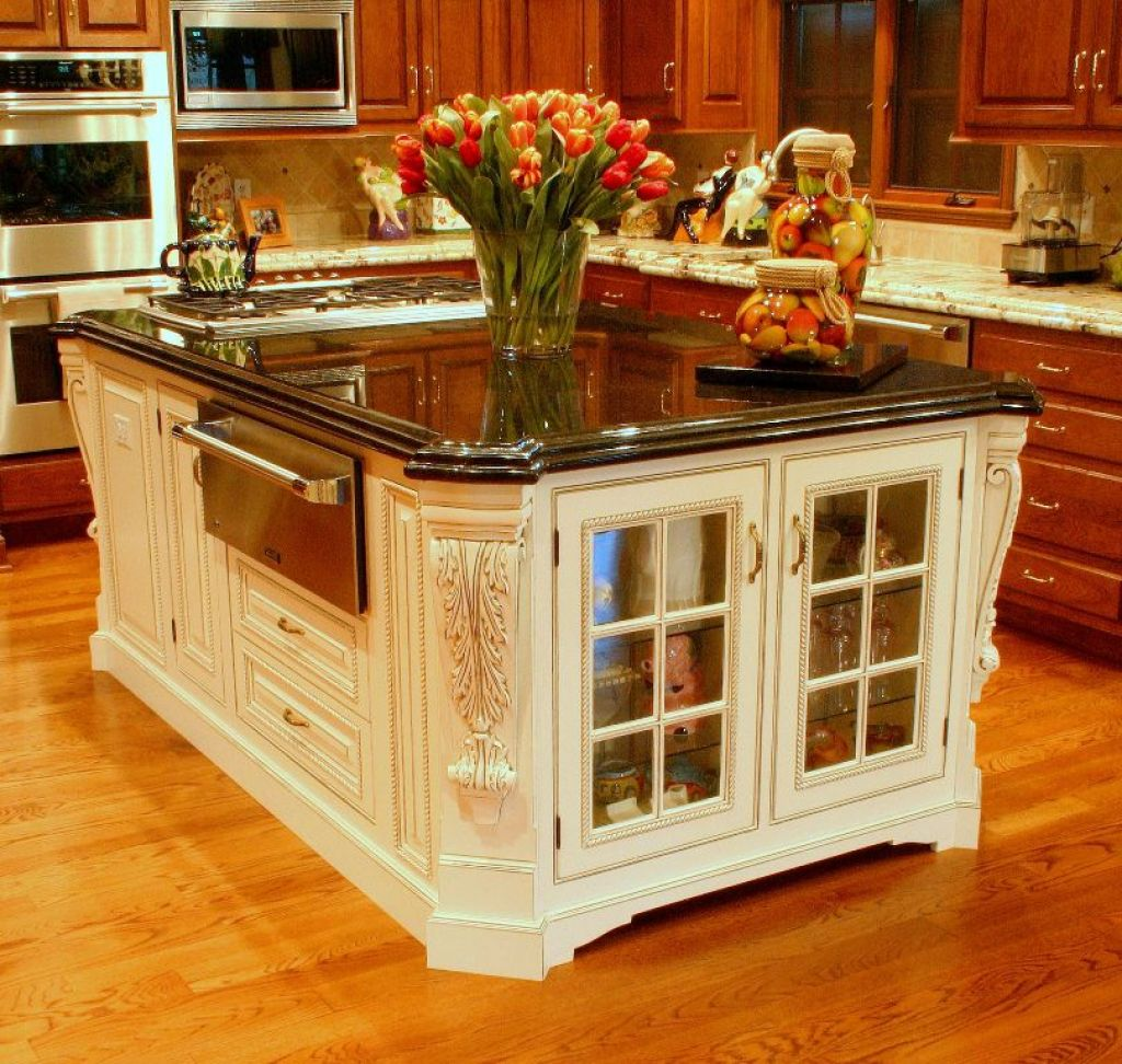 carved-kitchen-island-with-glass-doors 6 Affordable Organizing and Decoration Ideas for your Kitchen