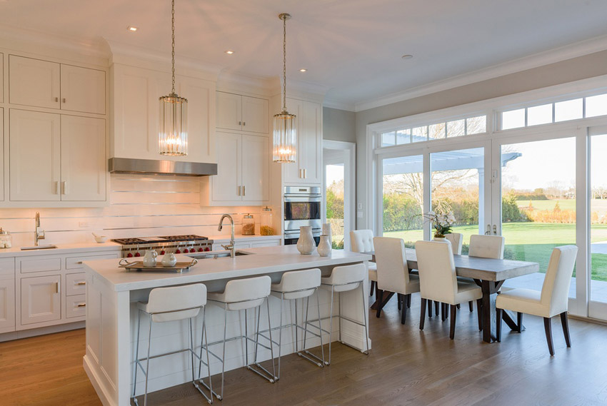 compact-white-kitchen-with-island-and-wolf-gas-range 6 Affordable Organizing and Decoration Ideas for your Kitchen