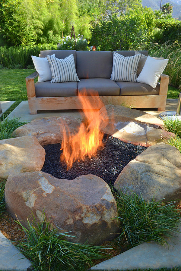 contemporary-patio-with-rustic-firepit 8 Delightful and Affordable Fire pit Decoration Designs in 2020