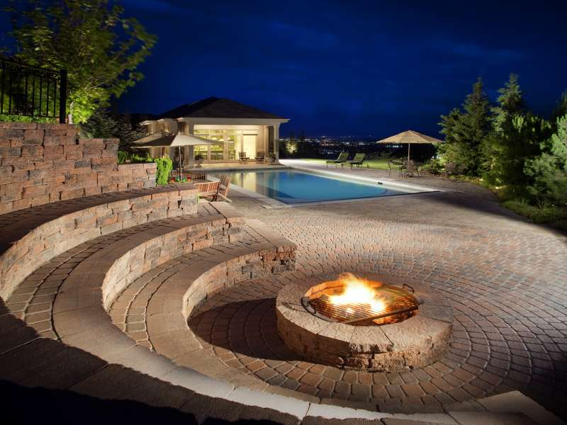 fire-pit-around-pool_0 8 Delightful and Affordable Fire pit Decoration Designs in 2020