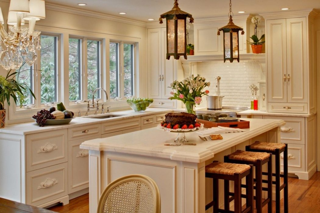 kitchen-with-white-cabinets-and-hanging-lanterns 6 Affordable Organizing and Decoration Ideas for your Kitchen