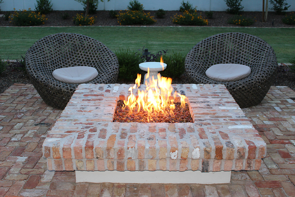 outdoor-settiing-amber-fireplace-1 8 Delightful and Affordable Fire pit Decoration Designs in 2020