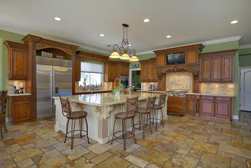 traditional-kitchen-with-rustic-cabinetry-large-island-and-travertine-floor-tiles 6 Affordable Organizing and Decoration Ideas for your Kitchen