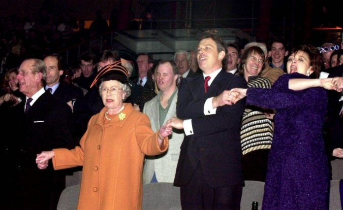New-Year-Holding-hands-and-singing-one-doesnt-cross-ones-arms-675x414 New Year around the World.. One Event, Various Traditions