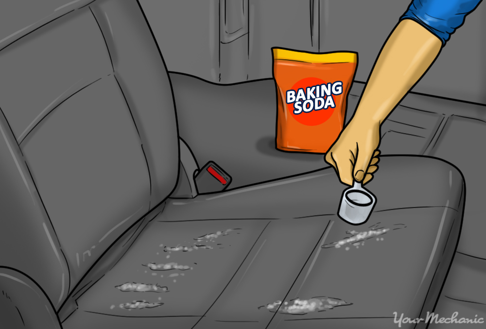4-How-to-Remove-the-Odor-of-Sour-Milk-From-Your-Car-baking-soda-being-applied-to-a-car-seat 5 Common Car Smells.. and How to Remove Them?