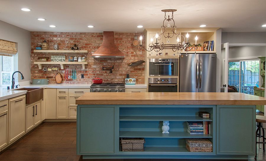 Brick-wall-adds-character-and-texture-to-the-spacious-kitchen-with-smart-island 13 Modern Ways to Decorate Your Kitchen!