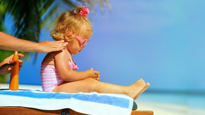 parent-applying-sunscreen-sunblock-daughter-675x379 10 Safe Ways to Get Summertime Tanned Easily