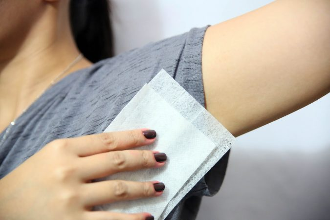 removing-armpit-marks-with-wipes-675x450 10 Fastest Ways to Get Rid of Deodorant Marks