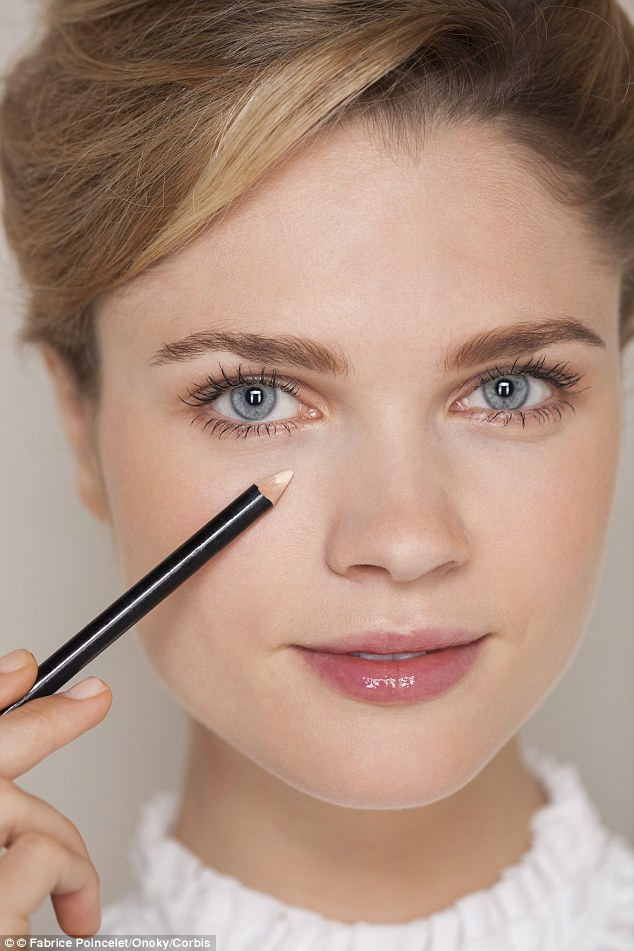 apply-some-of-the-concealer-above-your-eye Get Whiter Eye Whites with These 7 Exclusive Tips!