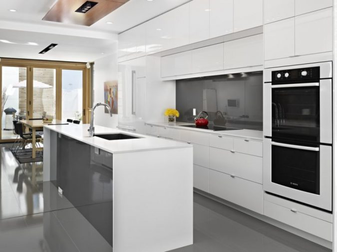 white-kitchen-with-glossy-cabinets-675x505 Top 10 Best White Bright Kitchen Design Ideas