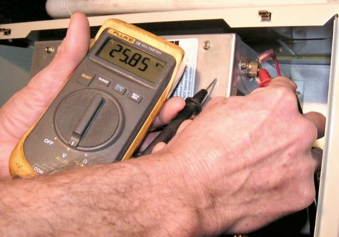 Check-the-burner-frames-675x472 5 Tips To Service Your Own Furnace During a Blistering Winter