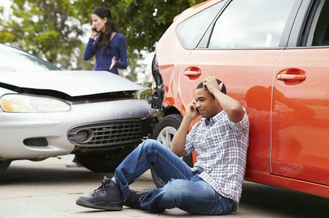 car-accident-calling-lawyer-675x449 What to Do After Getting Injured in a Car Accident