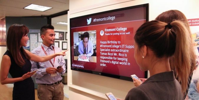 digital-signage-fremont-college-enplug-675x338 7 Reasons Digital Signage Gets Your Business More Customers
