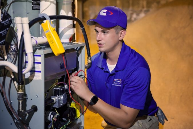Gas-Furnace-Repair-technician-675x450 7 Most Common Furnace & heating Problems