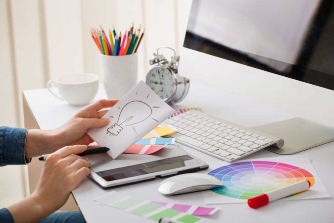 Graphic-Designer-2-675x450 7 Hidden Benefits of Using a Graphics Designer for Your Website