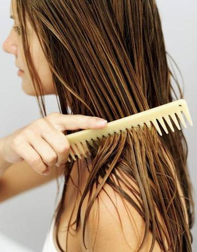 a-woman-brushing-her-wet-hair-mayonnaise-honey-hair-treatment Top 10 Best Hair Masks for Color Treated Hair