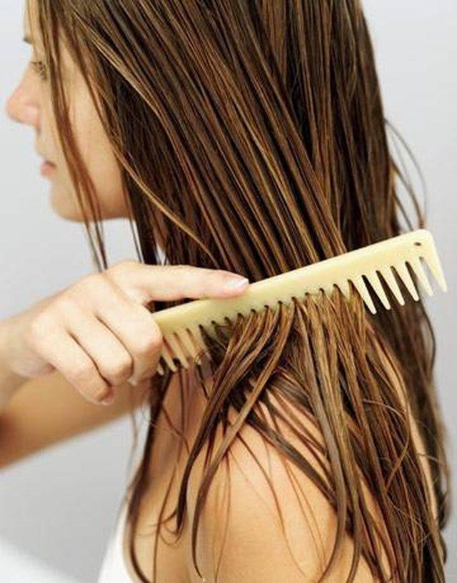 a-woman-brushing-her-wet-hair-mayonnaise-honey-hair-treatment Top 10 Best Hair Masks for Color Treated Hair