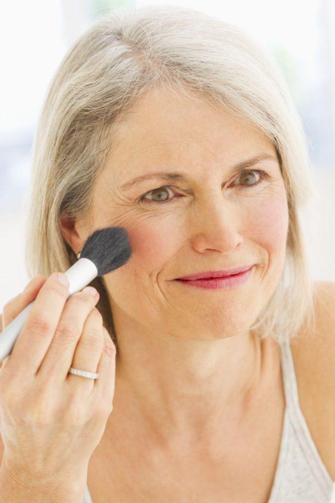applying-blush-mature-makeup-675x1014 Top 10 Makeup Tricks to Look Younger