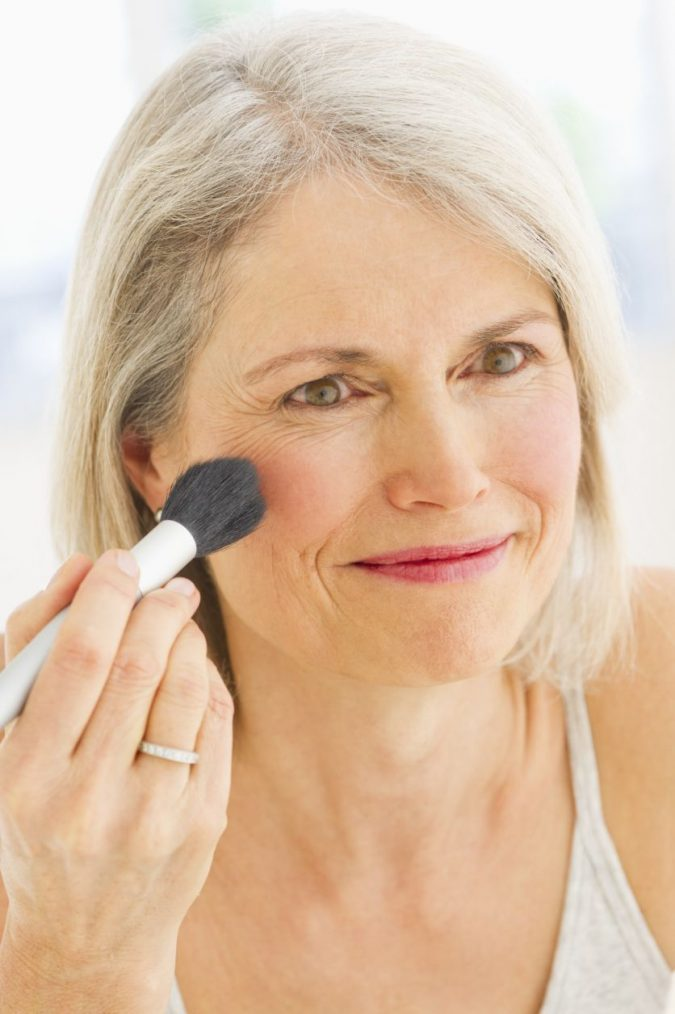 applying-blush-mature-makeup-675x1014 Top 10 Makeup Tricks to Look Younger