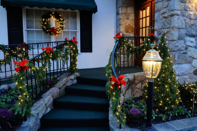 christmas-garland-porch-decorations-675x450 Top 10 Outdoor Christmas Light Ideas for 2018