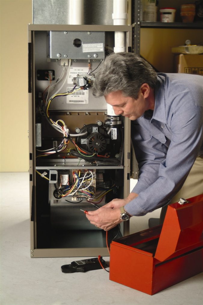 furnace-tech-675x1013 7 Most Common Furnace & heating Problems