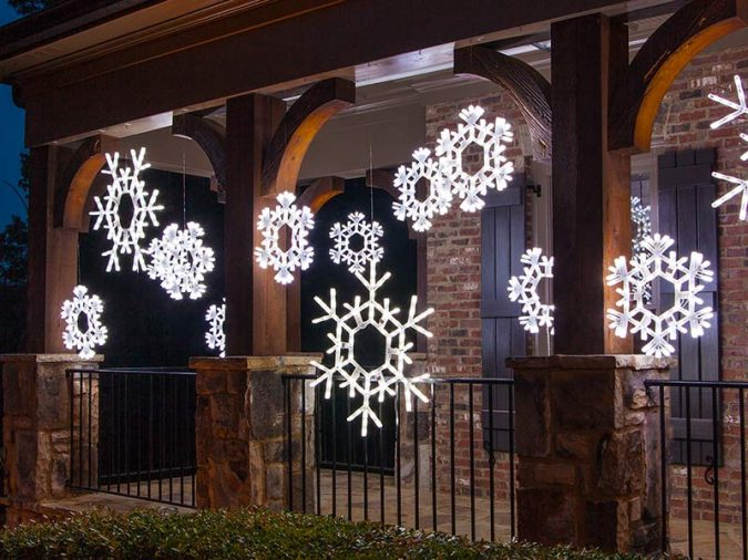 hanging-snowflake-lights-christmas-porch-decoration-675x506 Top 10 Outdoor Christmas Light Ideas for 2018