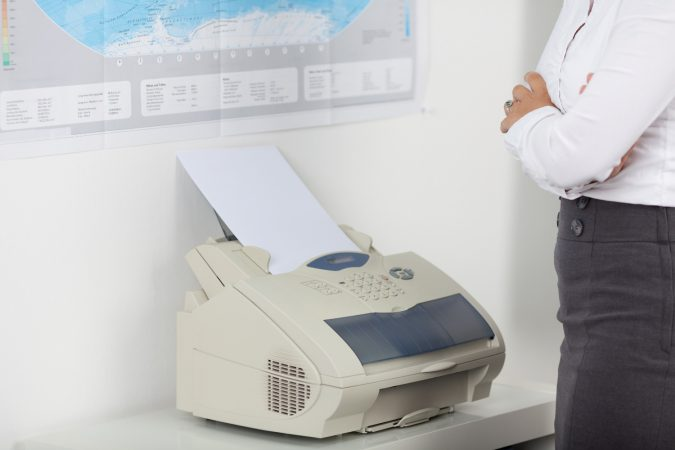 using-fax-machine-675x450 Top 10 Outdated Technologies Will Be Used Till 2018