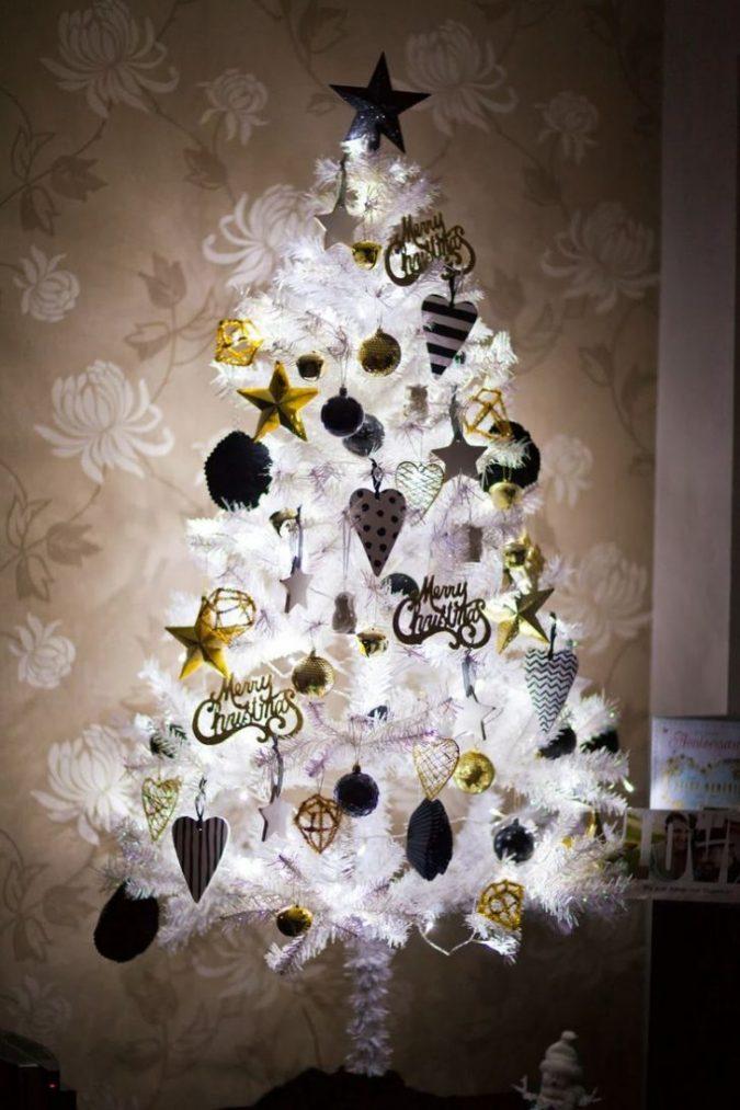 white christmas tree with black and gold decoration