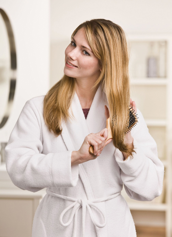woman-brushing-her-hair Top 10 Best Hair Masks for Color Treated Hair