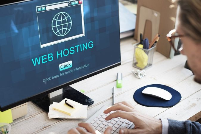 man-using-computer-web-hosting-675x450 Top 10 Web Hosting Features You Need for Your First Website