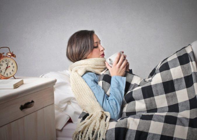 woman-having-hot-drink-675x478 5 Herbal Tea Infusions to Keep Winter Sickness at Bay