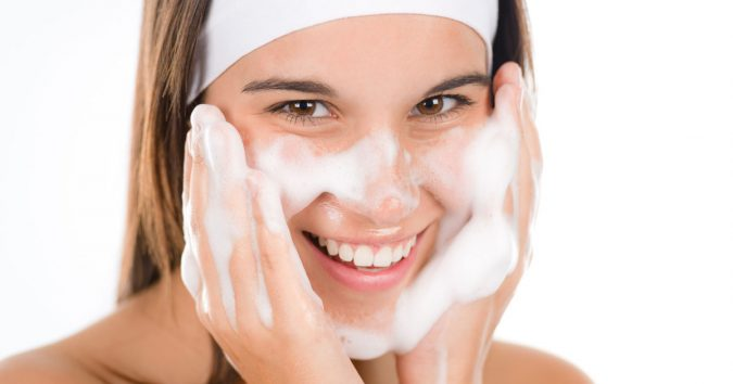 woman-washing-her-face-acne-675x354 9 Face Mapping Acne Spots and What Every Acne Spot Means?