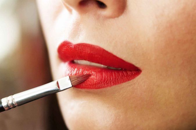 apply-red-lipstick-675x450 7 Tricks to Keep Your Lipstick Last Longer