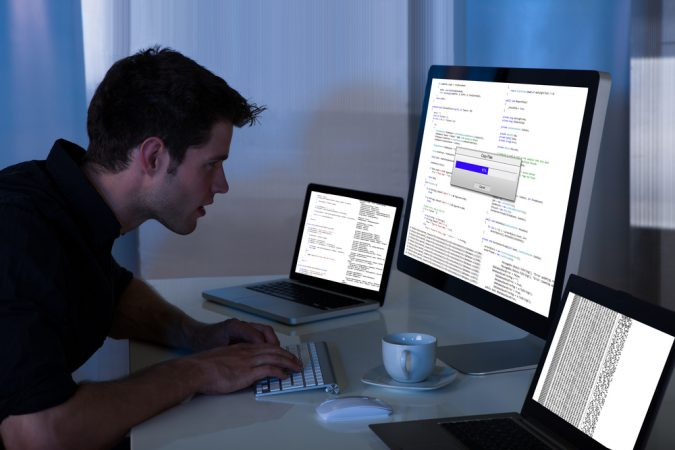 employee-working-on-a-computer-insider-threat-675x450 7 Criteria for Choosing Best Insider Threat Monitoring System