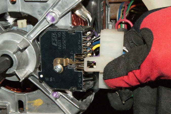 fixing-washing-machine-motor-675x453 Top 10 Washing Machine Parts That Need Repair in Canada