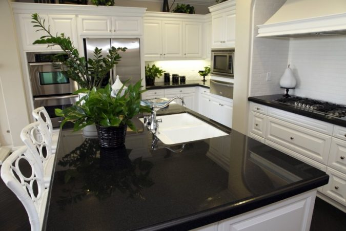 kitchen-with-black-Quartz-countertops-675x451 11 Tips on Mixing Antique and Modern Décor Styles